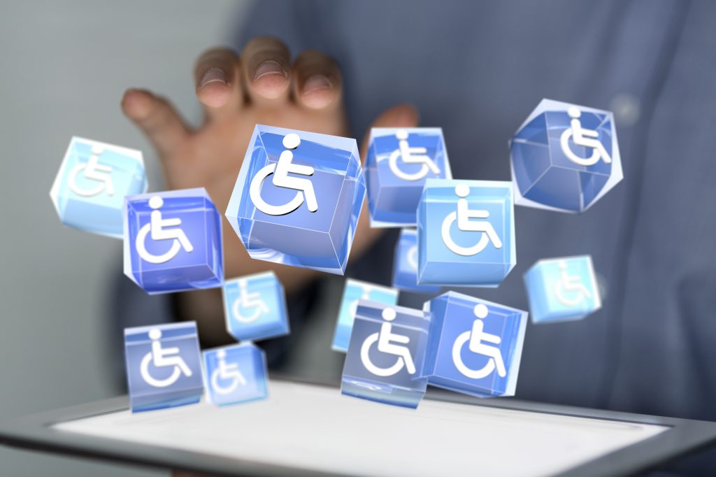 disability wheelchair logos over a tablet computer